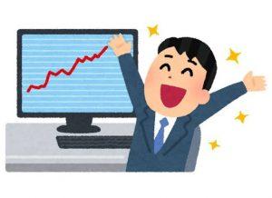 株価の上昇に喜ぶ男性